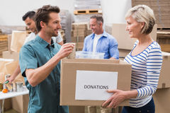 Two volunteers holding a donations box Stock Photography