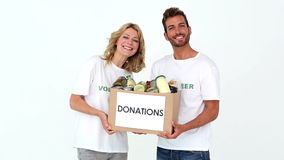 Two volunteers holding a donations box stock footage