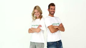 Two volunteers smiling at camera. On white background stock video footage