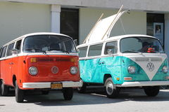 Two VW microbuses. Two old Volkswagen Microbus parked side by side outdoors on a sunny Miami day royalty free stock image