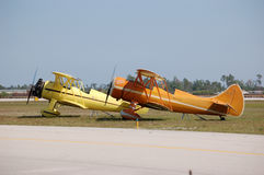 Two Waco Biplanes. Two Waco UPF-7 biplanes wait at the end of a taxiway stock photos