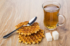 Two waffles, cup of tea, lumpy sugar and teaspoon Stock Photography