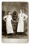 Two Waiters or Bakers. Early 1900 portrait of two brothers who are bakers stock images