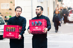 Two waiters carrying the crates of wine in the historic center of Rome, Italy. Royalty Free Stock Photo