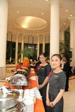 Two Waitress At Buffet Stock Images