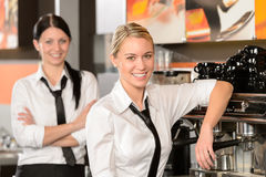 Two waitresses posing in coffee house. In uniform Royalty Free Stock Images
