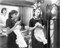 Two waitresses standing together. (All persons depicted are no longer living and no estate exists. Supplier grants that there will be no model release issues Royalty Free Stock Photo
