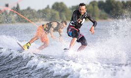 Two wake bord riders having fun Stock Photos