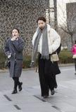 Two walking girls. Two fashion girls are walking Royalty Free Stock Images