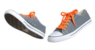 Two walking grey sneakers Royalty Free Stock Images