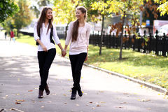 Two walking happy woman Royalty Free Stock Image