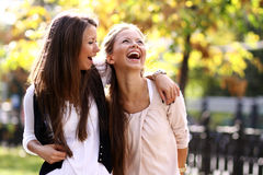 Two walking happy woman Royalty Free Stock Photography