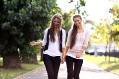 Two Walking Happy Woman Royalty Free Stock Photo