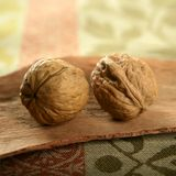 Two walnut over tablecloth Stock Photo