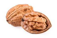 Two Walnuts whole and half in closeup. Royalty Free Stock Images