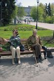 Two war veterans in Gorky park, they sit on a bench. Stock Photos