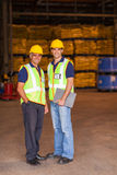 Two warehouse workers. Two shipping and warehouse worker portrait in workplace stock image