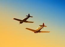 Two wartime planes. Classic military propeller planes flying side by side Stock Photography