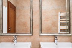 Two washbasins in beige toilet Stock Photo