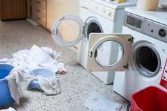 Two washing machines with the dirty laundry of the kindergarten Royalty Free Stock Images