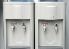 Two water coolers. Two water coolers side by side stock photo