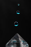 Two Water Drop & Crystal. High speed photography of 3 water drops falling on quartz crystal Stock Photo