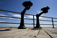 Two Water Fountains on a Deck. On a wooden deck of Brighton Beach, Atlantic Ocean Stock Photo