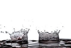Two water splash isolate white background royalty free stock photo