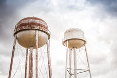 Two water towers Stock Images