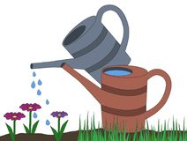 Two watering can gray orange on dirt and grass watering drops on Royalty Free Stock Photography