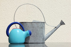 Two Watering Cans Stock Images
