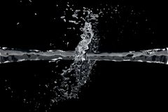 Two waterjet collide on a black background Royalty Free Stock Photography