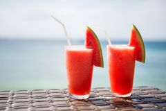 Two watermelon juices on a tropical beach Stock Photos