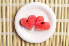 Two watermelon slices in the shape of hearts Stock Images