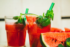 Two watermelon smoothie and fresh on a light wood background. selective focus to mint Stock Image