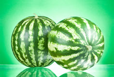 Two Watermelons isolated on a green Royalty Free Stock Photos