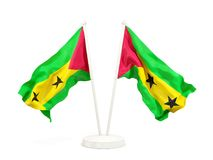 Two waving flags of sao tome and principe. Isolated on white. 3D illustration Royalty Free Stock Photo