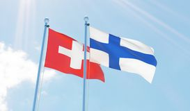 Two waving flags. Switzerland and Finland, two flags waving against blue sky. 3d image Royalty Free Stock Photos