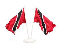 Two waving flags of trinidad and tobago. Isolated on white. 3D illustration Royalty Free Stock Images