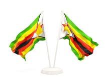 Two waving flags of zimbabwe Stock Photos