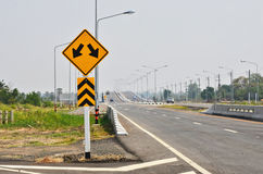 Two way junction and traffic island ahead warning sign Stock Image