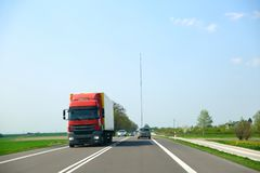 Two-way street with heavy traffic. Truck transport can also be found there. stock photos