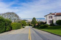 Two way street in the residential area of San Francisco; downtown views in the background, California stock photos