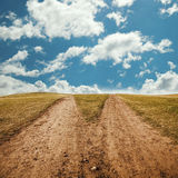 Two way to far away landscape with grass Stock Photo