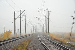 Two ways Railways in the fog Royalty Free Stock Image
