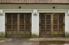 Two old weathered wooden garage doors. Two weathered old wooden garage doors royalty free stock photography