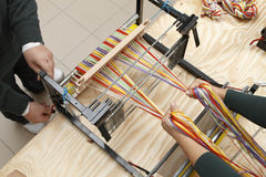 Two weavers. Working on a loom stock photo