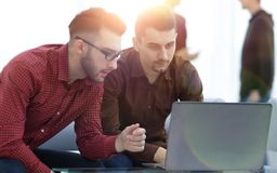 Two web designers discussing a project. In front of a laptop stock images