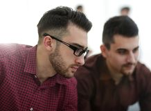 Two web designers discussing a project. In front of a laptop stock photos