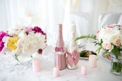 Two wedding bottles. Big Bouquets and Two champagne bottles. Goods for wedding. This photo is perfect for magazines, shops dealing with wedding dresses Royalty Free Stock Photo